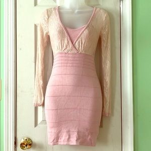 Bebe body-con dress in baby pink and cream